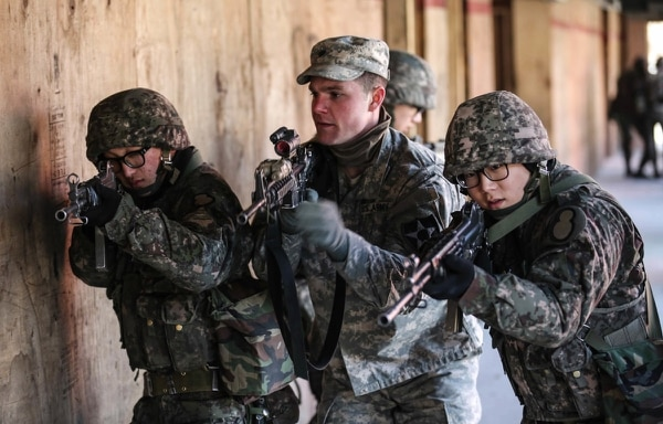 U.S. soldiers and Republic of Korea soldiers conduct an urban breaching at Rodriguez Live Fire Range, South Korea, March 9, 2016. (Staff. Sgt Kwadwo Frimpong/Army)