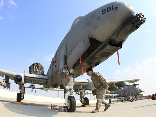 A US flight technician checks the body of a A-10 thunderbolt parked on the tarmac at the Namest air force base near Brno where it is taking part in joint NATO military exercises called Ramstein Rover. The exercise is organized and managed by the Air Force Component Command HQ AC Ramstein. It is the largest military exercise in Europe this year with the participation of 16 countries and the objective of increasing coordination between pilots and forward operating air controllers. AFP PHOTO/ RADEK MICA (Photo credit should read RADEK MICA/AFP/GettyImages)