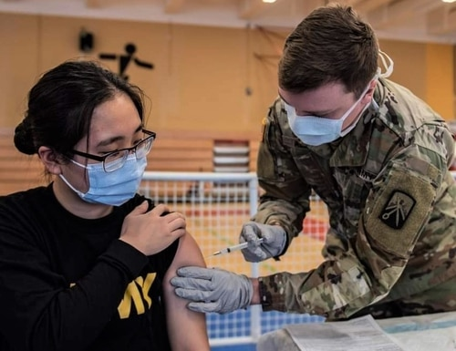 Army Spc. Hana Lee, a dental specialist assigned to the Baumholder Army Dental Clinic, receives her first dose of the COVID vaccine. (Military Health System Europe)