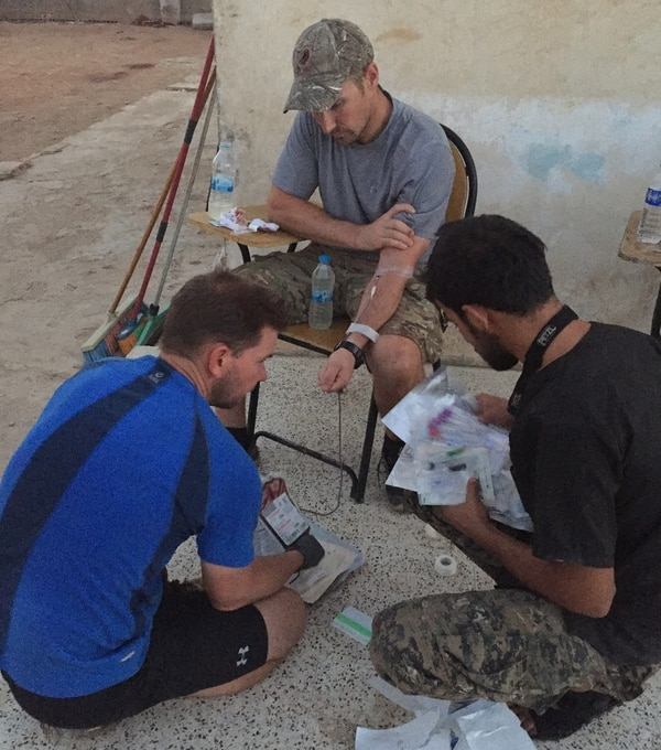 Capt. Cade Reedy, an emergency room nurse with the Special Operations Surgical Team, gives blood to save a local fighter who was badly wounded fighting the Islamic State. Reedy's donation saved the fighter's life. After that, the local fighters trusted the team completely and gave them whatever supplies they needed. (Air Force)