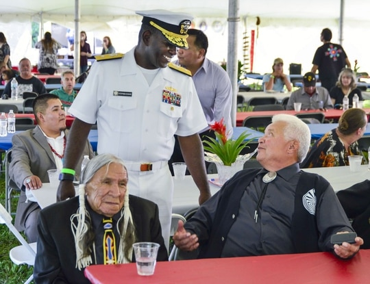 WEATON, Ill. (Aug. 19, 2016) Rear Adm. Stephen C. Evans, commander, Naval Service Training Command, talks to American Indian veterans Manuel Mendivil (right) and Saginaw Grant (left), during the 2nd Annual National Gathering of American Indian Veterans at Cantigny Park. (U.S. Navy photo by Mass Communication Specialist 2nd Class Derek Paumen/Released)