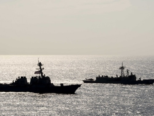 The Arleigh Burke-class guided-missile destroyer Preble and the Royal Australian Navy Adelaide-class guided-missile frigate Melbourne sail in formation during a cooperative deployment in the Philippine Sea on April 18. (Mass Communication Specialist 1st Class Bryan Niegel/Navy)