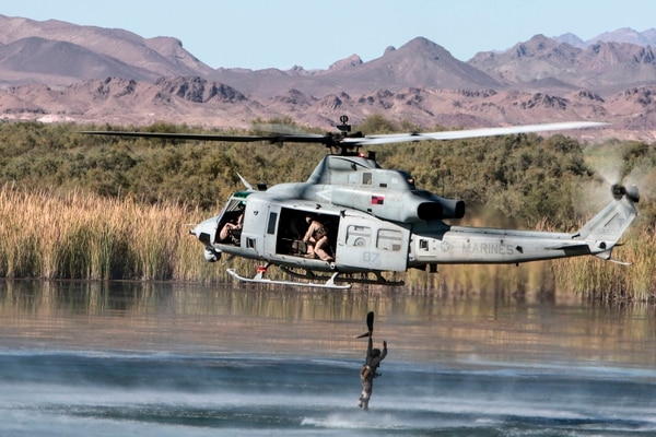 A U.S. Marine with 1st Force Reconnaissance Company, 1st Marine Expeditionary Force conducts a helocast exercise out of a UH-1Y Venom at Ferguson Lake, near Yuma, Arizona, Oct. 3, 2015. (Staff Sgt. Artur Shvartsberg/ Marine Corps)