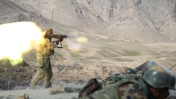 An U.S. Special Forces soldier assigned to Combined Joint Special Operations Task Force-Afghanistan fires a Carl Gustav recoilless rifle system after receiving small-arms fire during a clearance of Denasaro Kelay village in Mizan district, Zabul province, Afghanistan on March 8, 2014. 3rd SOK, assisted by USSF soldiers, conducted the clearance to disrupt insurgent movement in the area. (U.S. Army photo by Spc. Sara Wakai/ Released)