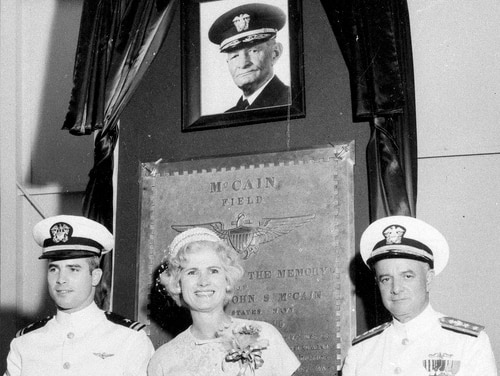 In this July 14, 1961, file photo, then-Lt. John S. McCain III, left, and his parents, Rear Adm. John S. McCain Jr. and Roberta Wright McCain take part in the ceremony to commission McCain Field, the U.S. Navy training base in Meridian, Miss., named in honor of Adm. John S. McCain, pictured in a photo above, respectively, grandfather and father to the two McCains. (AP)