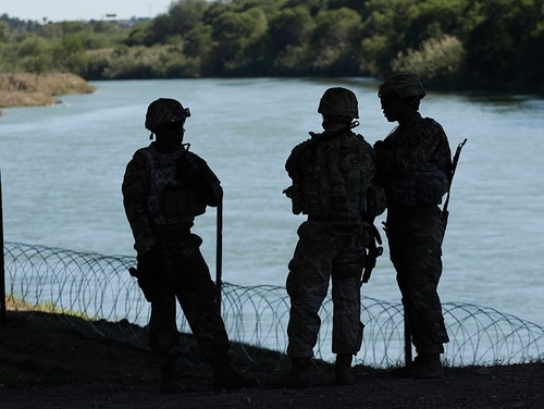Members of the U.S. military install multiple tiers of concertina wire along the banks of the Rio Grande near the Juarez-Lincoln Bridge at the U.S.-Mexico border, Friday, Nov. 16, 2018, in Laredo, Texas. (Eric Gay/AP)