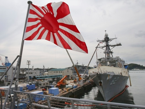 Japan's military flag, the Rising Sun Flag, flutters on the Japan Maritime Self-Defense Force tank landing ship JS Kunisaki anchored in Yokosuka near Tokyo, getting ready for participating in the Pacific Partnership 2014 four years ago. South Korea has reiterated a demand that Japan should remove its