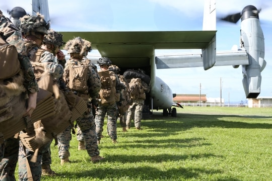 Marines with 1st Battalion, 6th Marine Regiment, attached to 3rd Marine Division under the Unit Deployment Program, board an MV-22 Osprey during an expeditionary advance base operation exercise at Camp Schwab, Okinawa, Japan, June 17, 2020. (Cpl. Donovan Massieperez/Marine Corps)