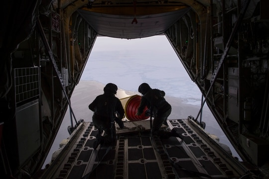 An Air-Deployable Expendable Ice Buoy is sent into the Arctic in 2017 from a Royal Danish Air Force C-130 aircraft operating out of Thule Air Base in Greenland as part of the International Arctic Buoy Program. (John F. Williams/U.S. Navy)