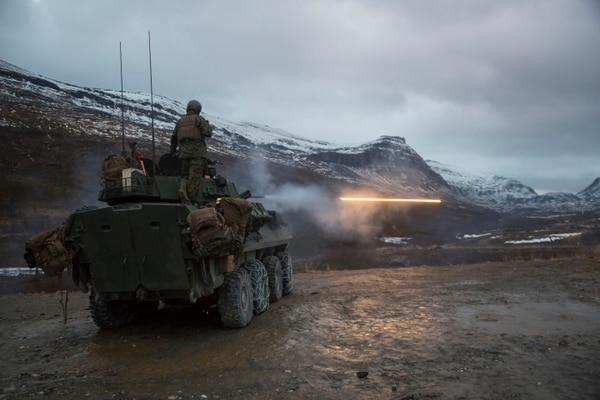 U.S. Marines with Marine Rotational Force-Europe 19.1 (MRF-E) fire rounds from a Light Armored Vehicle during Exercise Northern Screen at Setermoen, Norway, Nov. 5, 2018. The exercise increases the Marines' proficiency in cold-weather, arctic, and mountainous environments. (Cpl. Ashley McLaughlin/Marine Corps)