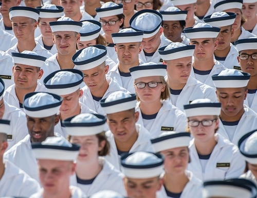 Incoming midshipmen participate in the Oath of Office Ceremony, during induction day (I-day) at the U.S. Naval Academy in Annapolis, Maryland, June 29, 2017. Increasing numbers of midshipmen are majoring in cyber operations, according to the academy. (Mass Communication Specialist 1st Class Patrick Enright/Navy)