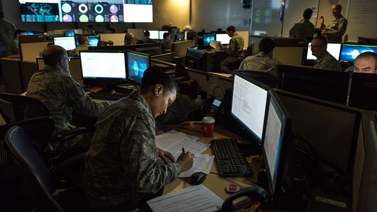 With the rapid pace of operations, top cyber commanders are coming away with a wealth of knowledge that requires more frequent updates to doctrine. (J.M. Eddins Jr./Air Force)