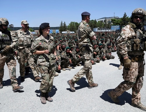 In this May 27, 2019, file photo, NATO forces attend the graduation ceremony of Afghan National Army soldiers from a 3-month training program at the Afghan Military Academy in Kabul, Afghanistan. (Rahmat Gul/AP)