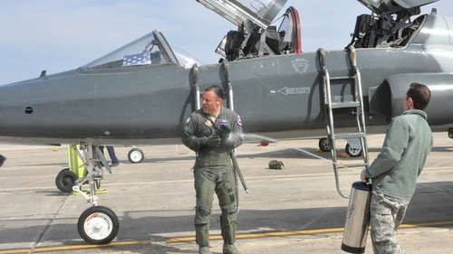 Lt. Col. Joe Mirarchi's brother, Master Sgt. Michael Mirarchi, Joint Base San Antonio-Lackland, congratulated his brother on his safe fini flight with the traditional wet down. (Debbie Gildea/Air Force).