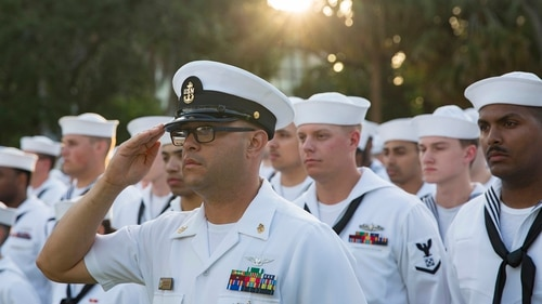 Chief Aviation Boatswain's Mate Jaime Valencia salutes for a formation of sailors assigned to the USS Kearsarge at a welcoming party during Fleet Week Port Everglades in Florida on May 1, 2018. Senate lawmakers backed plans for a smaller military end strength increase for fiscal 2019 than the White House requested, including 3,500 fewer sailors. (MC3 Dana D. Legg/Navy)