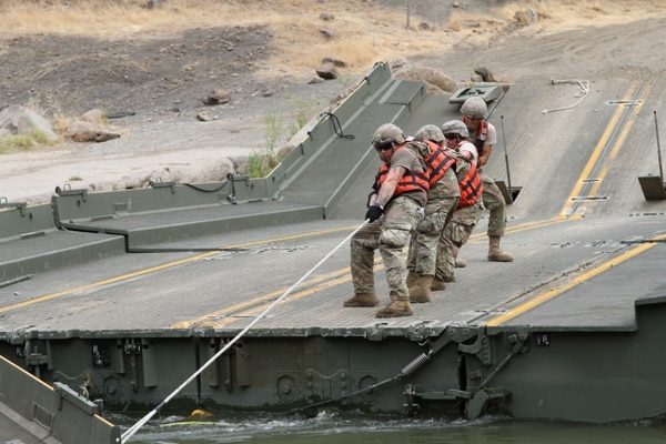 U.S. Army engineers constructed a temporary floating bridge to support the California Department of Forestry and Fire Protection. (Staff Sgt. Eddie Siguenza/Army)