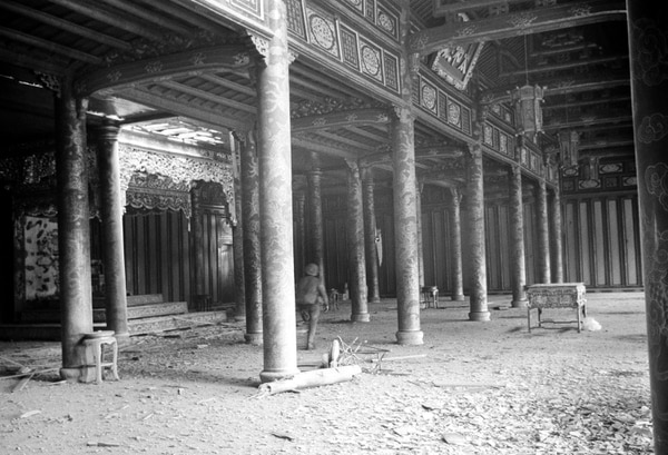 A U.S. service member walks among dirt and debris of battle at the ornate Imperial Palace in the Citadel of Hue, Vietnam during the Tet Offensive in February 1968. (Eddie Adams/AP)
