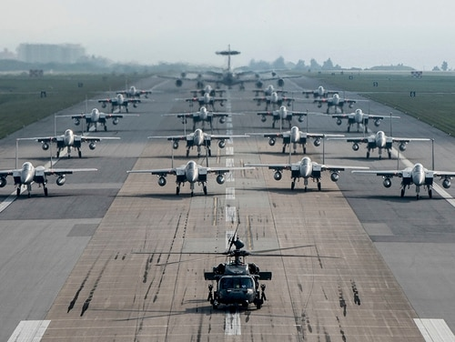 Fully armed aircraft from the 18th Wing conduct an elephant walk during a no-notice exercise April 12, 2017, at Kadena Air Base, Japan. (Senior Airman John Linzmeier/Air Force)
