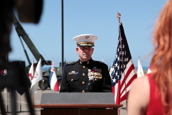 U.S. Marine Corps Maj. Gen. Joseph L. Osterman, Commander, U.S. Marine Corps Forces Special Operations Command, addresses media representatives following the Navy Cross Medal and Bronze Star Medal Ceremony held to honor members of Marine Special Operations Team 8131 at Camp Pendleton, Calif., April 9, 2015. On June 14, 2012, while deployed to Afghanistan, the Marine Special Operations Team 8131 simultaneously conducted counterattacks against the enemy, established village stability and evacuation of two Marine casualties in Upper Gereshk Valley of Helmand Province. (U.S. Marine Corps photo by Sgt. Maricela M. Bryant, MCIWEST-MCB CamPen Combat Camera/Released)