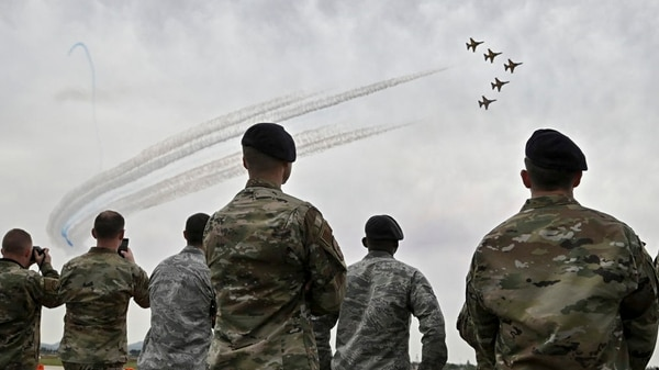 U.S. soldiers look at a performance of the Black Eagles, the aerobatic team of T-50 jets belonging to South Korea's Air Force. (Jung Yeon-je/AFP via Getty Images)
