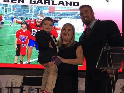 From left: Cooper Dean, Katie Dean and Ben Garland attend the Atlanta Falcons community honors dinner. (Tragedy Assistance Program for Survivors)