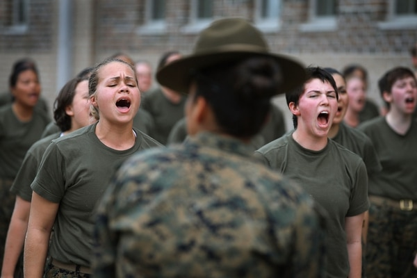 Drill Instructor Staff Sgt. Jennifer Garza disciplines her Marine recruits with some unscheduled physical training in the sand pit outside their barracks during boot camp February 27, 2013 at MCRD Parris Island, South Carolina. (Scott Olson/Getty Images)