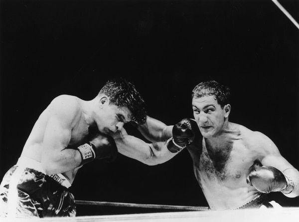 24th September 1953: Rocky Marciano (1923 - 1969), right, and Roland La Straza fight for the heavyweight title on Sept. 24, 1953, at the Polo Grounds in New York. Marciano won by a knock out in the 11th round. (Keystone/Getty Images)