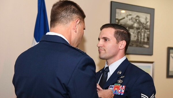 Tech. Sgt. Cam Kelsch, a tactical air control party operator with the 17th Special Tactics Squadron, is presented a Silver Star by Maj. Gen. Vincent Becklund, deputy commander of Air Force Special Operations Command. (Senior Airman Rachel Yates/Air Force)