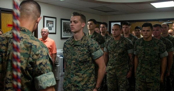 Lance Cpl. Dillon Bennett, machine gunner, 3rd Battalion, 7th Marine Regiment, receives a Purple Heart July 2. (Lance Cpl. Dave Flores/Marine Corps)