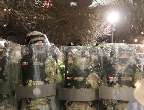 Members of the Washington D.C. National Guard are holding the line against the last remnants of the mob who broke into the U.S. Capitol on Jan. 6. (Philip Athey/Staff)