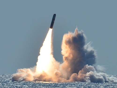 An unarmed Trident II D5 missile launches from the Ohio-class ballistic missile submarine Nebraska off the coast of California on March 26, 2018. Highly trained sailors who routinely perform important missions under stress are perfect candidates for national laboratories, this op-ed author says. (Mass Communication Specialist 1st Class Ronald Gutridge/Navy)