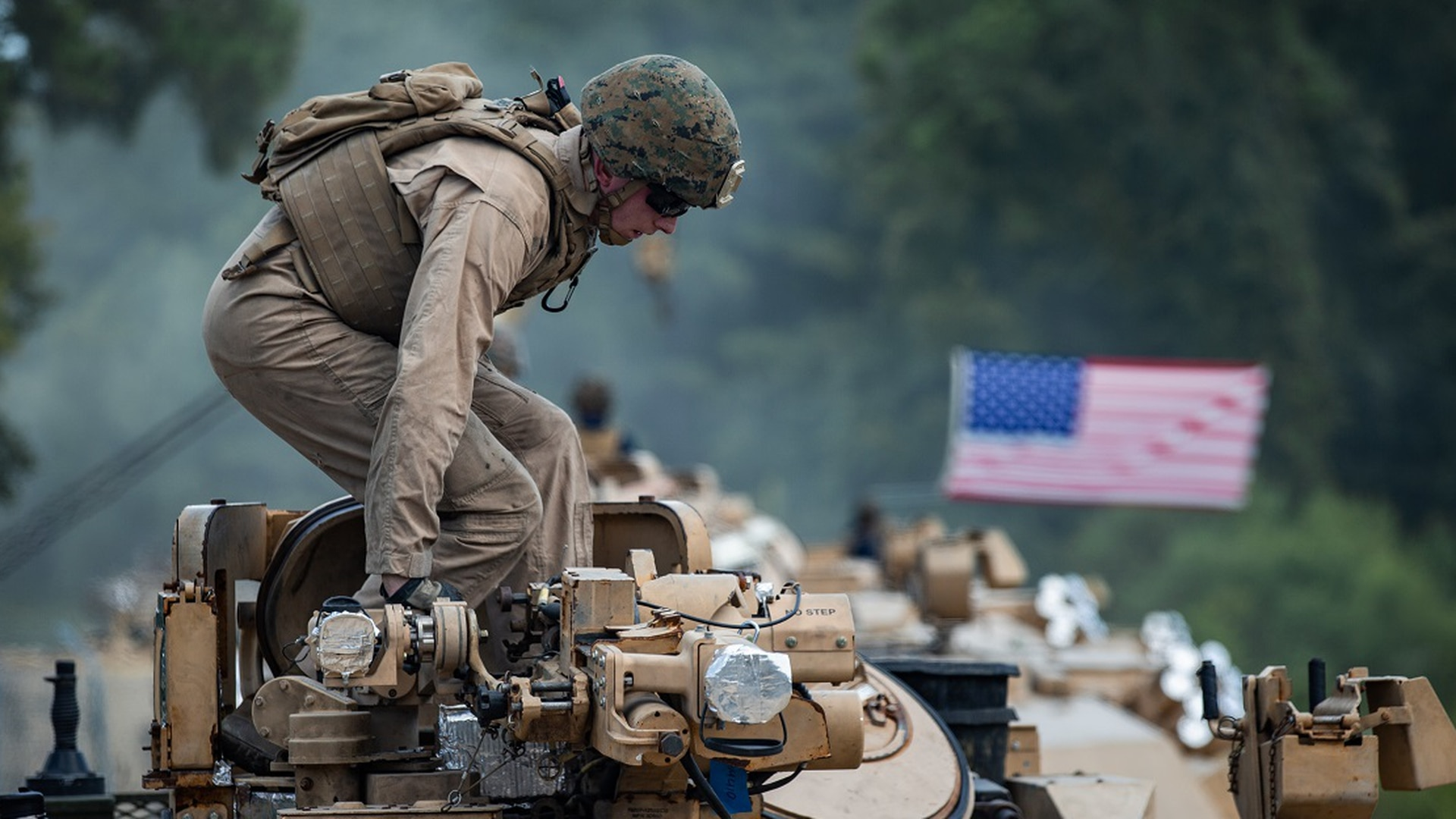 A U.S. Marine with 2d Tank Battalion, 2d Marine Division, prepares to depart from a tank lot on Camp Lejeune, North Carolina, July 27, 2020. (Lance Cpl. Patrick King/Marine Corps)