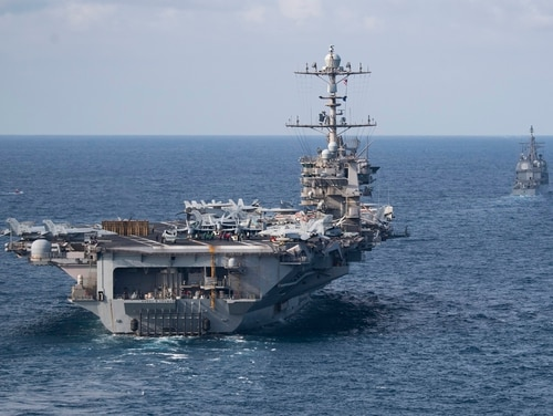 The carrier Harry S. Truman and the cruiser Normandy transit the Atlantic Ocean. Truman's deployment has been extended to avoid having it pull into port amid a global pandemic. (US Navy photo by MC2 Scott Swofford)