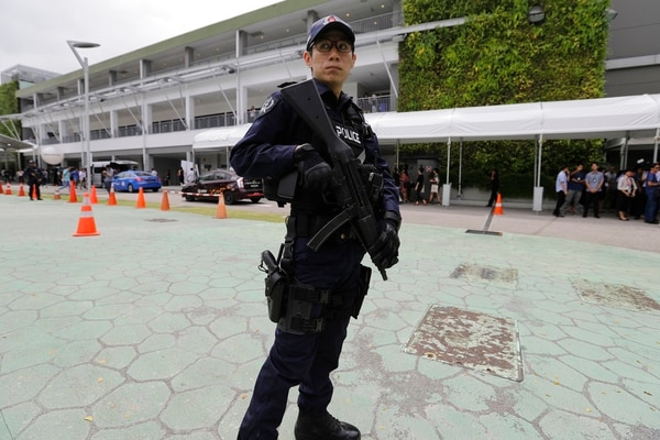 A police officer guards the entrance of the international media center Sunday, June 10, 2018, in Singapore ahead of the summit between U.S. President Donald Trump and North Korean leader Kim Jong Un on June 12. (Wong Maye-E/AP)