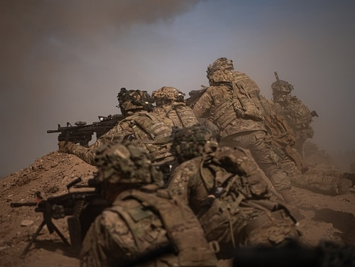 U.S. Army paratroopers move up on a berm to provide security for the assaulting element on July 29, 2020, during a company live-fire exercise. (Sgt. John Yountz/U.S. Army)