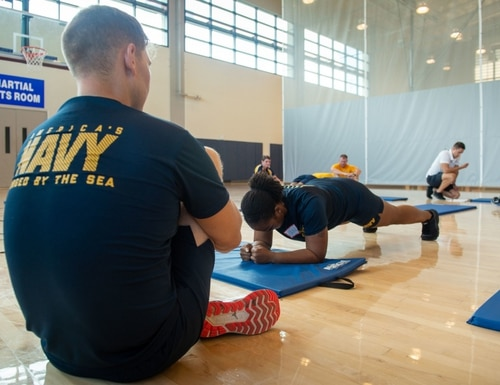 Retail Services Specialist 2nd Class Danielle Young performs a plank during a new physical readiness test. (MC2 Cole Pielop/Navy)