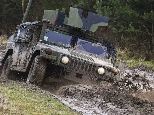 Soldiers maneuver a Humvee through a driver's training terrain course as part of the basic driving class at the 7th Army Training Command's Grafenwoehr Training Area, Germany, Jan. 9, 2018. (Gertud Zach/Army)