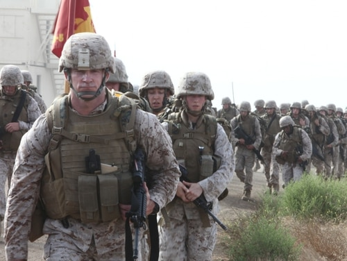 Sgt. Maj. Troy E. Black, then the battalion Sergeant Major of Combat Logistics Battalion 5, 1st Marine Logistics Group, leads his battalion during a hike at Camp Pendleton, California, in 2011. (Pfc. Timothy Childers/Marine Corps)