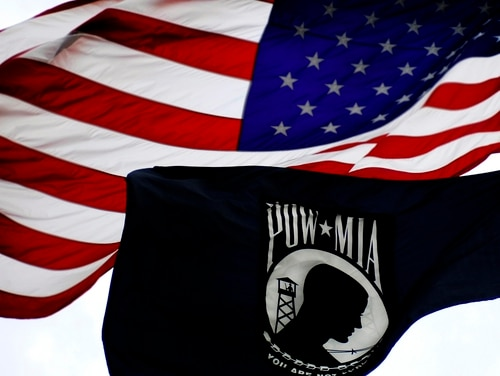 American flag and POW/MIA Flag fly high. (Staff Sgt. Kenny Holston/Air Force)