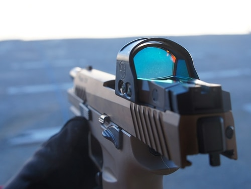 The Army's new M17 handgun is shown with a Sig Sauer reflex sight during range day at the 2018 SHOT Show in Las Vegas, Nev. (Christian Lowe/Staff)