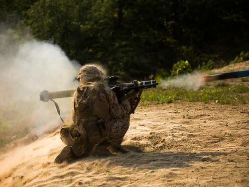 An infantry assault Marine fires a shoulder-launched, multipurpose assault weapon. (Lance Cpl. Robert Williams Jr./Marine Corps)