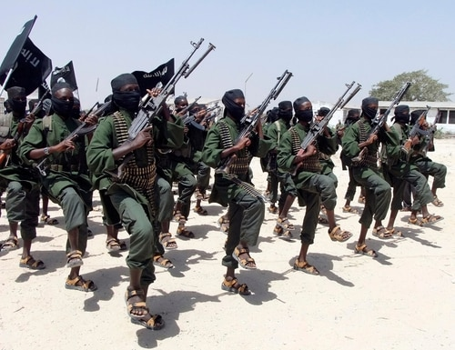 In this file photo from Feb.17, 2011, hundreds of newly trained al-Shabaab fighters perform military exercises in the Lafofe area some 18 km south of Mogadishu, Somalia. (Farah Abdi Warsameh/AP)