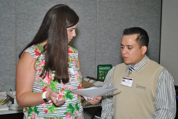 Chrissy Littledale, a transition specialist with Hire Heroes USA, discusses resume tips with a veteran at a workshop in Los Angeles. Hire Heroes USA provides free career coaching and job sourcing to transitioning service members, veterans and military spouses. (Provided by Chrissy Littledale)