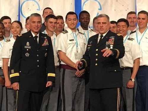 Lt. Gen. Paul Nakasone, commander of Army Cyber Command, left, and Gen. Mark Milley, Army chief of staff, join cadets at the International Conference on Cyber Conflict on Tuesday in Washington. (Kathy Curthoys/Staff)