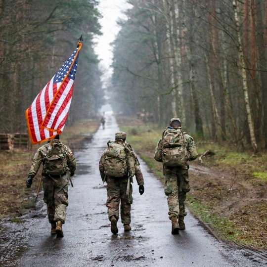 Soldiers ruck march with the flag on March 6, 2020. (Master Sgt. Ryan Matson/Army)