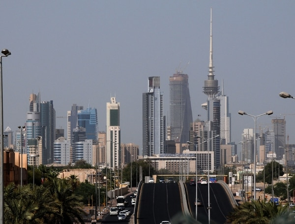 FILE - This July 19, 2009 file photo shows the Kuwait city skyline. The oil-rich, tiny country of Kuwait is still shaped by the 1991 Gulf War. Twenty-five years later, there is a freely elected parliament in place but problems persist and many fear Kuwait could be gripped by the same regional tensions at play across the greater Middle East. (AP Photo, File)