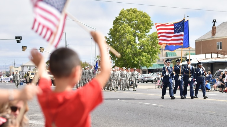 Members of the Travis Air Force Base Honor Guard march along Sonoma St. in Vallejo, Calif., during the city's annual Independence Day Parade, July 4, 2017. About 75 Airmen from the 60th Medical Group and 821st Contingency Response Squadron also participated in the parade, with residents cheering them along a 1.5-mile path through the city. (U.S. Air Force photo by Ken Wright)