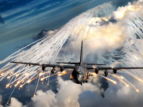 An AC-130U gunship jettisons flares during training over Hurlburt Field, Fla. (Senior Airman Julianne Showalter/Air Force)