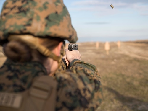 A U.S. Marine assigned to the 24th Marine Expeditionary Unit, Female Engagement Team, fires a pistol during a live-fire range on March 20, 2017, at Capu Midia training grounds in Romania. (Cpl. Brianna Gaudi/Marine Corps)