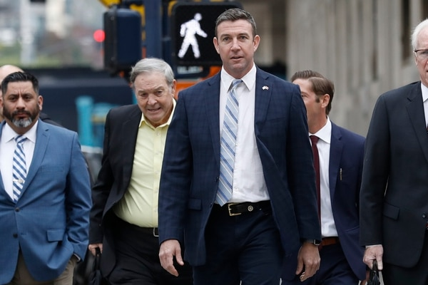 California Republican Rep. Duncan Hunter, center, walks towards federal court in front of his father, former Rep. Duncan L. Hunter, left, Tuesday, Dec. 3, 2019, in San Diego. (Gregory Bull/AP)